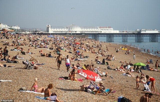 People enjoy the hot weather at Brighton beach today as temperatures soared with the UK enjoying an Indian summer
