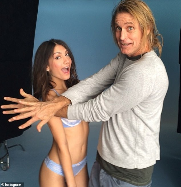 After the friend drooled over the photos of his young daughter, Cohen eagerly pulls up photos of a shoot Samantha had done with Victoria's Secret photographer Russell James.A photo from Samantha's Instagram account posted on December 13, 2013, shows her posing with James, who sheepishly blocks out her cleavage with his hands (pictured)