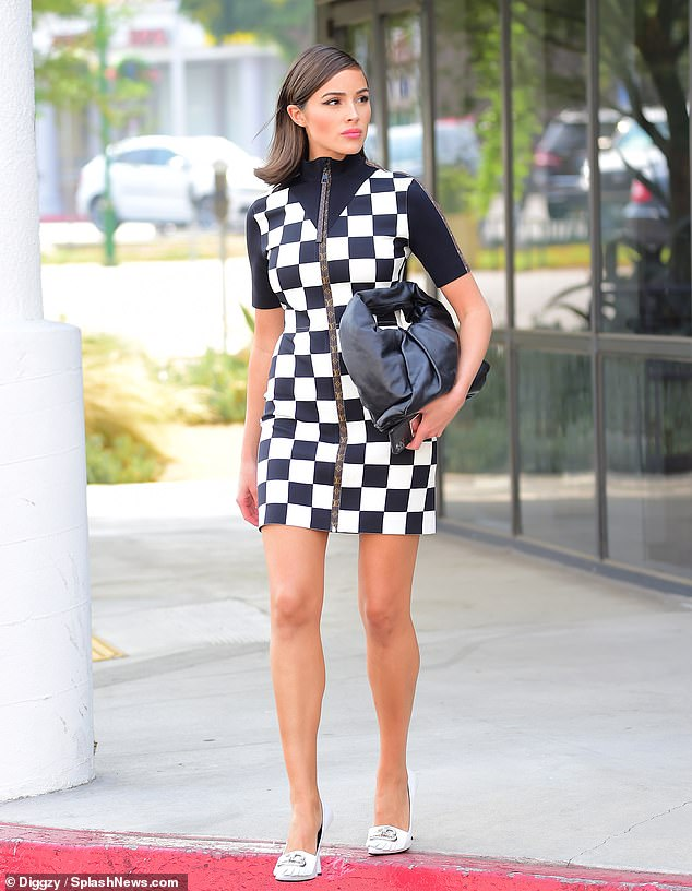 Dressed to impress: Olivia Culpo was all business on Monday, getting dressed up in a stunning Louis Vuitton checkerboard dress as she stepped out for a business meeting in Los Angeles