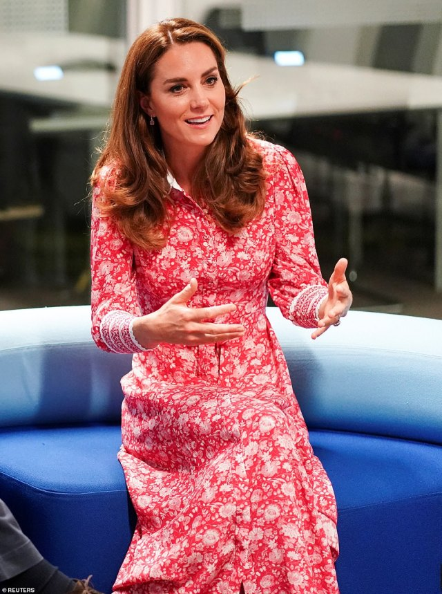 The Duchess rewore her stunning £550 Beulah midi dress for the occasion and appeared animated as she spoke with employers at the job centre