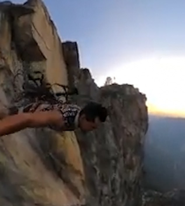 The man was using a safety line put in place to help climbers making their way up the cliff
