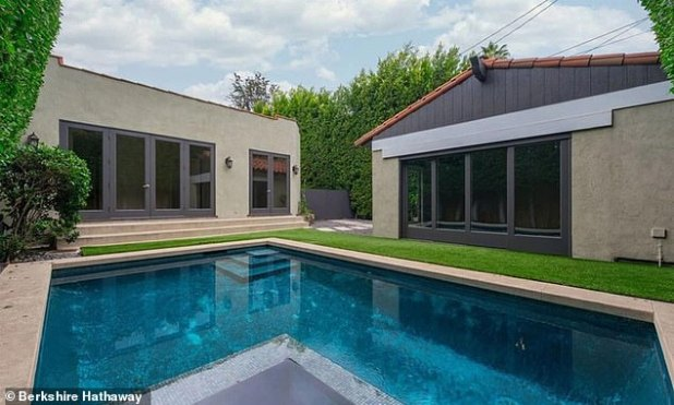 Outdoor Fun: Shiny green grass surrounds the pool for easy outdoor recreation near a studio guesthouse that was converted from a two-car garage