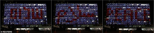 """The word """"Peace"""" is seen in Hebrew, Arabic and English on a municipality building in Tel Aviv"""