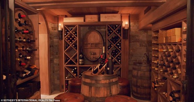 The home is equipped with a lower-level wine cellar (pictured) and tasting room