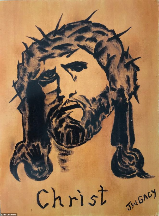 Above, a painting of Jesus by serial killer John Wayne Gacy, which is part of Chalmers' collection. He told DailyMail.com that some pieces are gifts sent to him while some things are donated and given to him by law enforcement and others