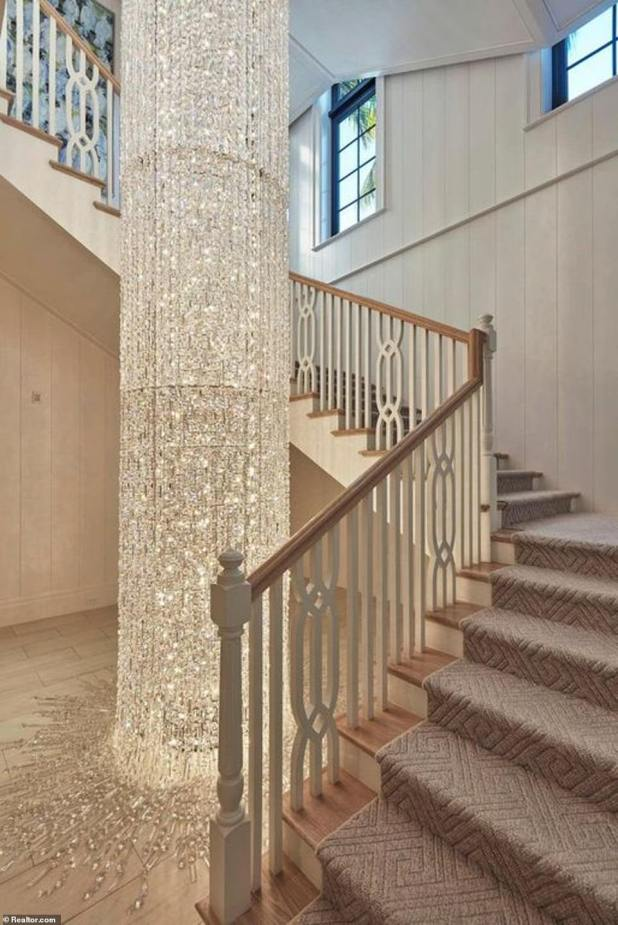 Another special feature of the property is that a three-story Swarovski crystal chandelier has a statement climbing the illuminated stairs.