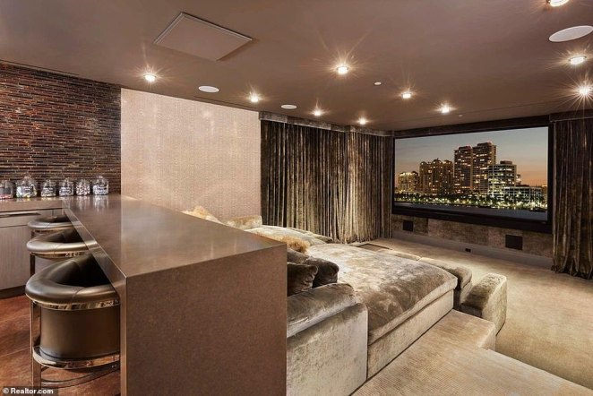 The home's cozy theater comes complete with a private bar area