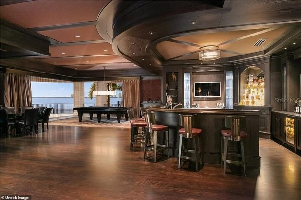 Extra: The home's spacious 'club room' comes with a full-service bar, billiards and games table
