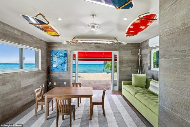 Florida estate: A cabana with a surfboard theme opens directly onto the sand