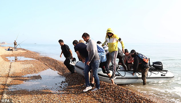 On Monday, an overloaded dinghy carrying ten such migrants landed in Kent's Kingsdown village (pictured)