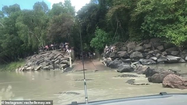 Video footage captured the terrifying moment a couple were stuck in the middle of Cahills Crossing (pictured), a popular spot in Kakadu National Park, notorious for saltwater crocodiles