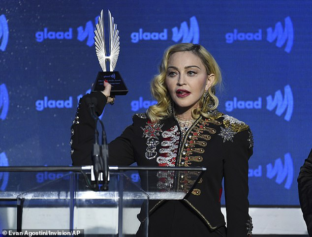 The latest: Madonna, 62, will direct her own biopic from Universal Pictures, and will co-write the motion picture with Academy Award winner Diablo Cody, she said in a statement Tuesday