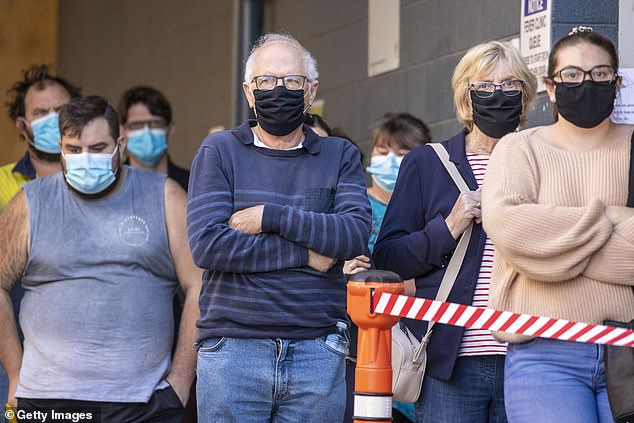 Queenslanders are seen lining up to be tested for Covid-19 at a testing clinic at Ipswich Hospital on August 24