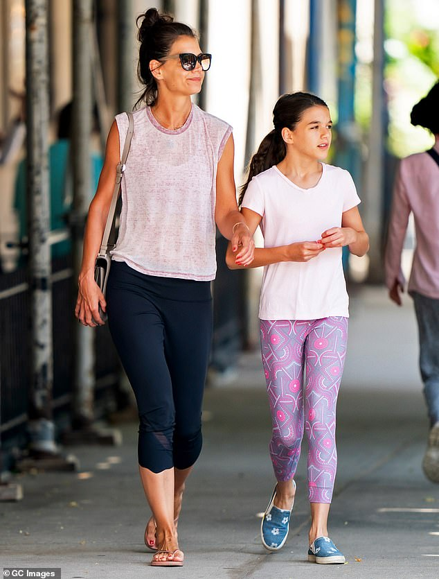 Family is everything: Holmes lives in NYC with her daughter Suri Cruise, whom she shares with Tom; pictured with Suri in July 2019
