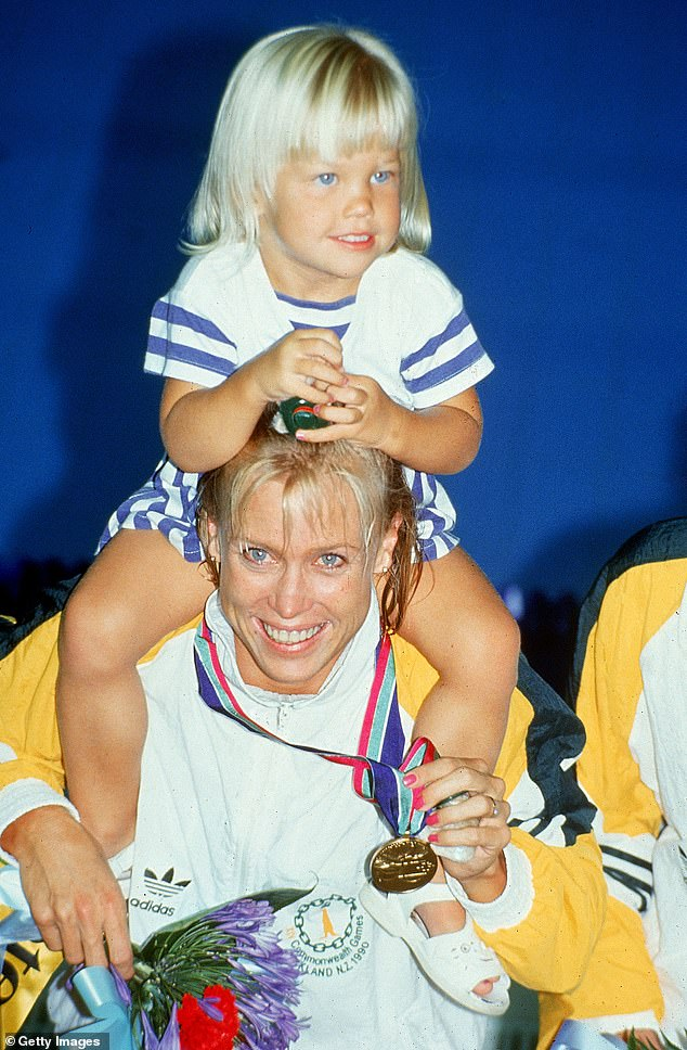 Jaimi Kenny sits on her mother's shoulders as she returns from the Auckland Commonwealth Games in 1990 with a gold medal around her neck
