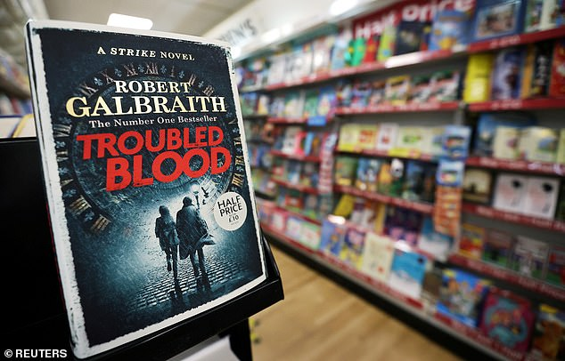 Rowling became embroiled in another trans row on Sunday after an early review of the her latest novel, Troubled Blood (pictured), by the The Telegraph revealed it featured a 'transvestite serial killer' who wore women's clothing while murdering his victims