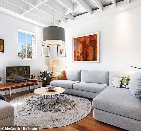 Natural light floods into the downstairs and upstairs living room (pictured)