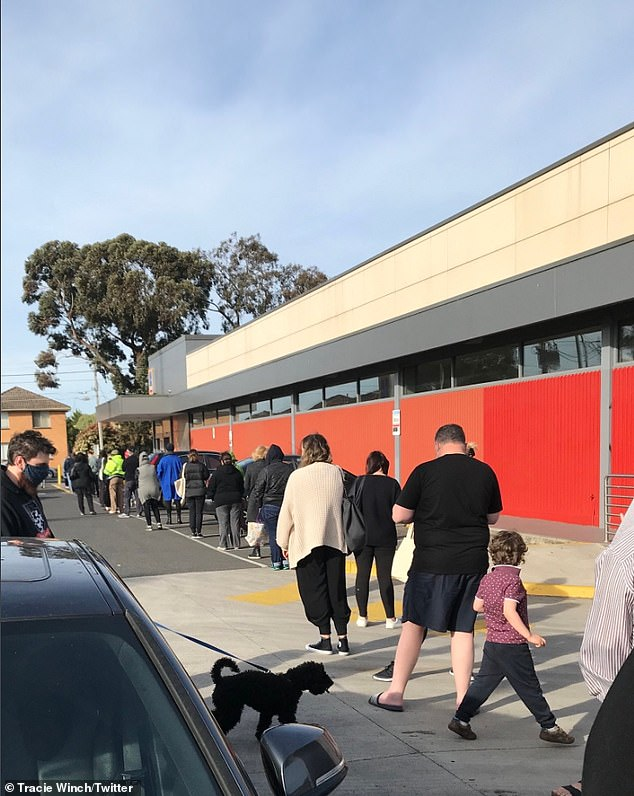 Large queues of bargain hunters were pictured outside several Melbourne stores on Wednesday morning, despite COVID-19 restrictions (Pictured: Aldi's Preston store)