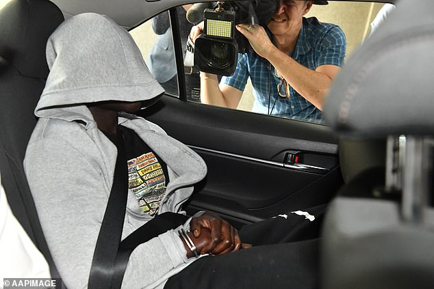 Pictured: A suspect is taken to Brisbane Watch House on Wednesday