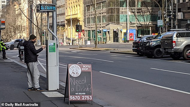 At least 450 motorists will be reimbursed over 'unfair' fines issued by the City of Melbourne. Pictured is a motorist paying for parking in the Melbourne CBD