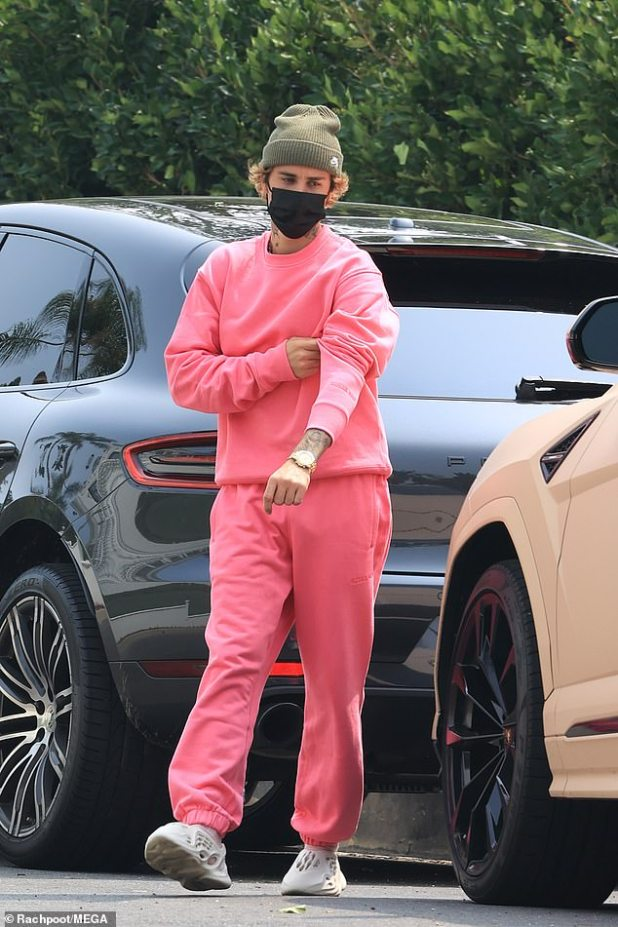 Bold Look: Justin Bieber stood out at the Hot Pink Co-ordination on Tuesday afternoon as he made his latest appearance with wife Hailey