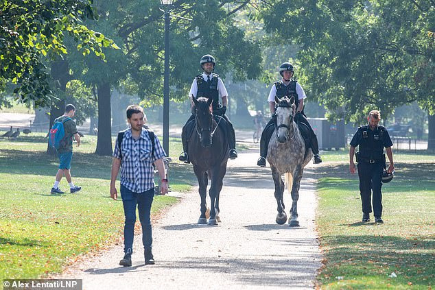 Police on patrol enforcing the new social distancing laws in sunny Hyde Park yesterday