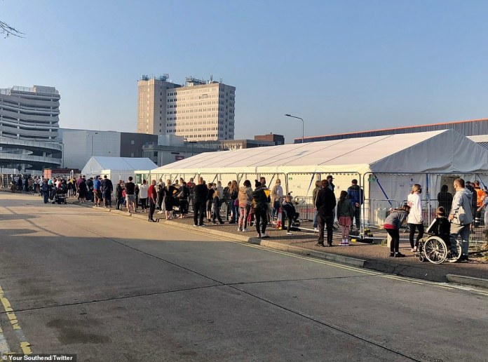 Hundreds are seen queuing to receive a coronavirus test in Southend, London, yesterday. It comes as people struggle to book tests online, with many receiving a message saying the system is 'very busy'