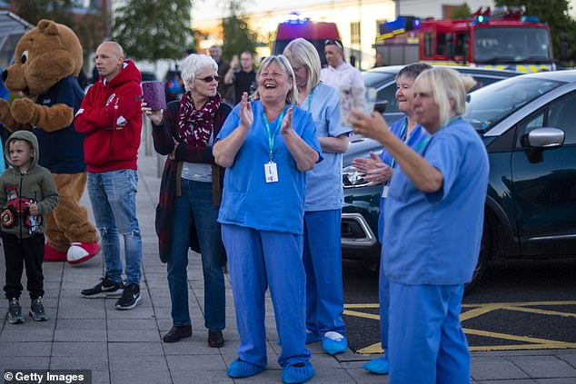 The NHS reviewed whether the hospital has stringent infection control, preventing the coronavirus from spreading between patients and staff. According to sources, official were satisfied. Pictured: Staff 'Clap for Carers' on May 14