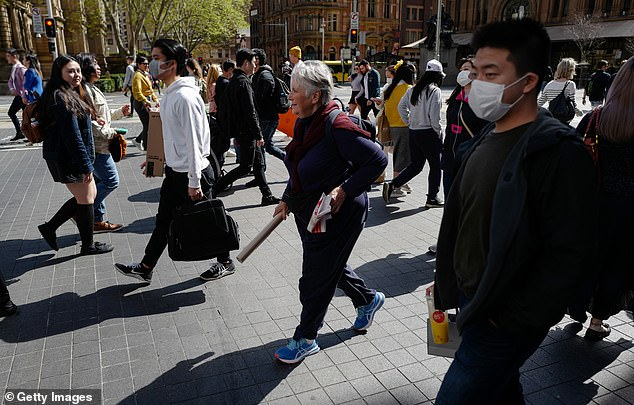 People out shopping in Sydney CBD wearing face masks on September 5, as the state remains on high alert