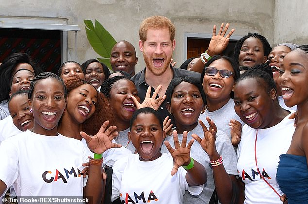 Prince Harry meets women from CAMA, the alumnae network of CAMFED, in Zambia in 2018