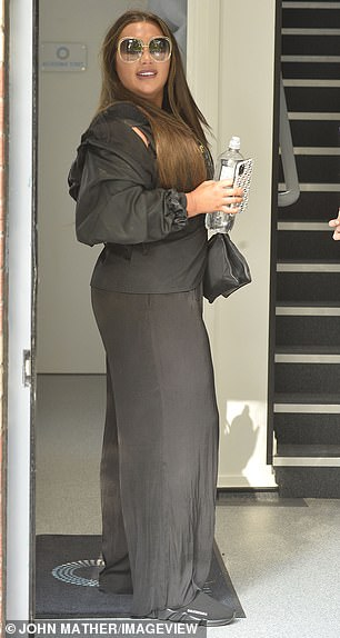 Low-key: The former TOWIE star, 33, opted for comfort in a waterproof jacket, a sleek blouse and wide-leg trousers
