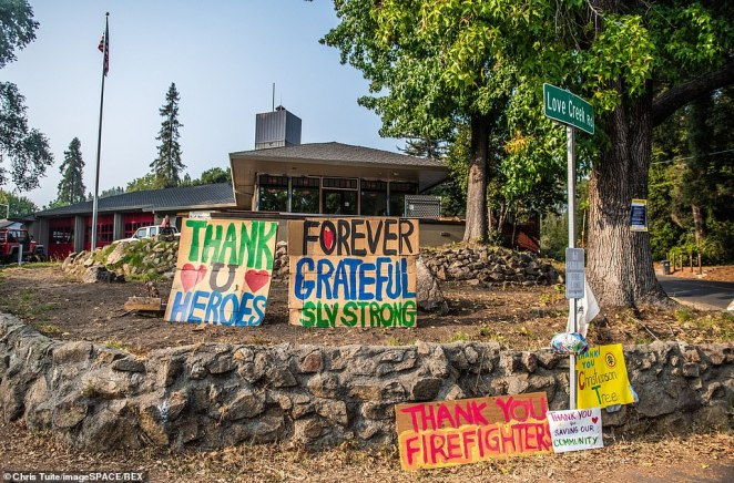 In California locals have put up signs to thank firefights after the CZU Lightning complex fire tore through parts of Felton in Santa Cruz County