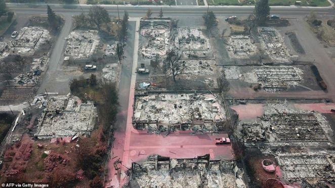 Homes were flattened to the ground, trees blackened with ash and streets covered with pink fire retardant in the Almeda Fire in Talent, Oregon. The blaze still destroyed 600 residences and killed three people