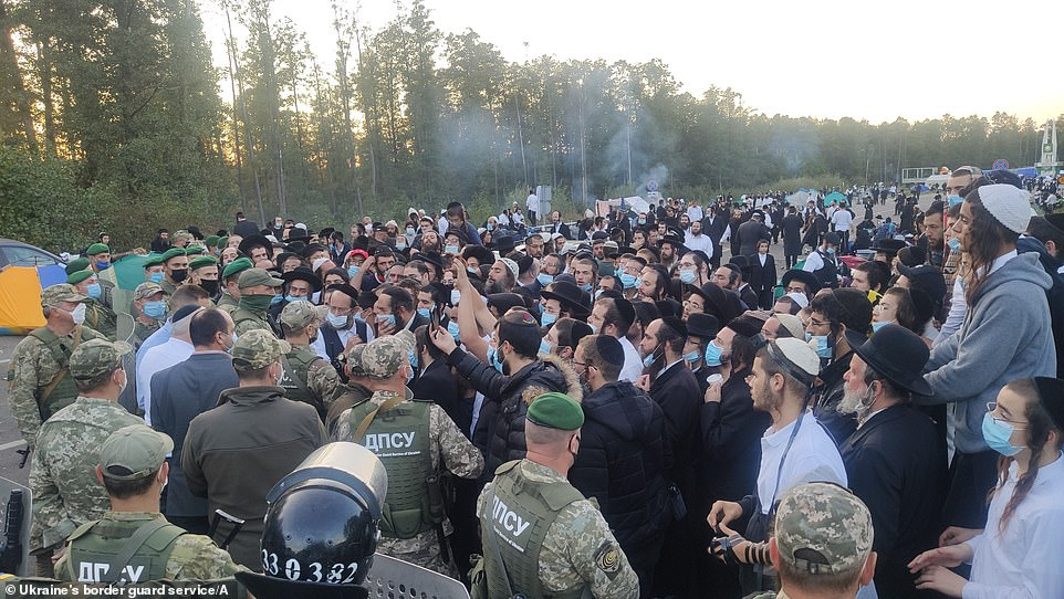 An image release by Ukraine's border guard agency shows hundreds of Jews gathered at the checkpoint on Wednesday as they hope to make their annual pilgrimage to Uman