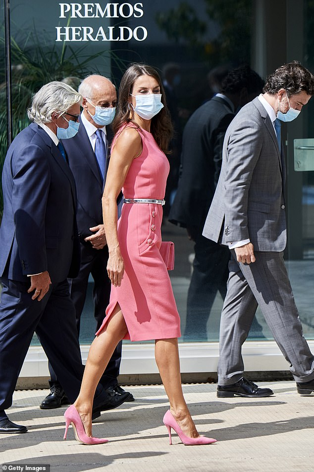 Letizia went for a total look, sporting the sleeveless pink dress with a clutch and heels of the same colour