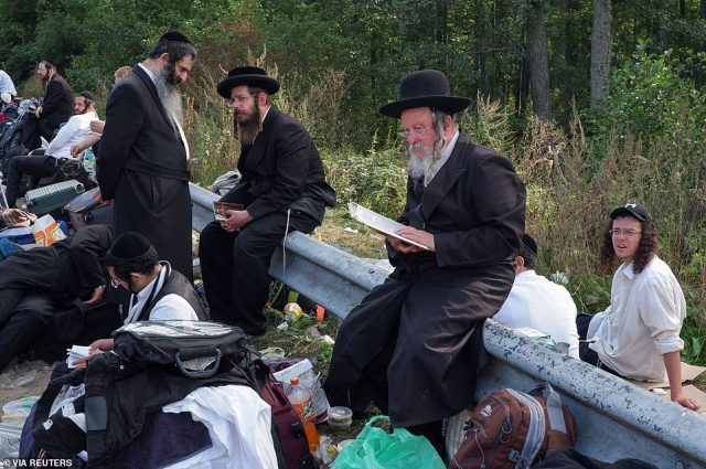 Jewish pilgrims, who plan to enter Ukraine for a pilgrimage from the territory of Belarus, gather at Novi Yarylovychi crossing point in Chernihiv Region, Ukraine September 15, 2020. Picture taken September 15