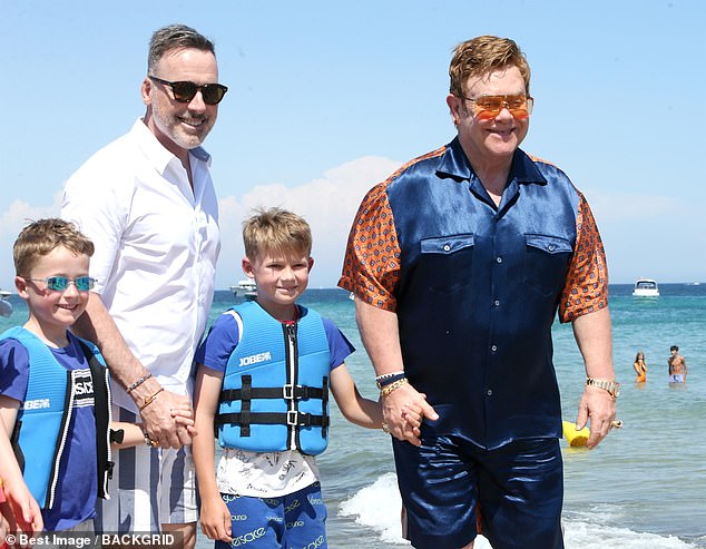 Elton John has two sons, Zachary, nine, and Elijah, seven, with his husband David Furnish. They were both said to have been born to the same unnamed California-based surrogate mother. Pictured: The family on holiday in St Tropez last year