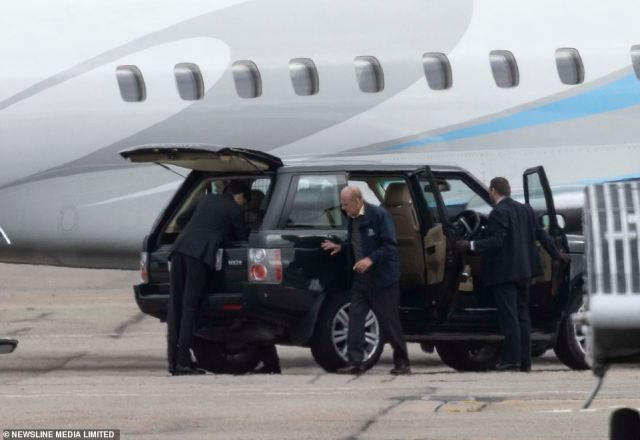 The royal, pictured, could be seen carefully walking around the edge of his car to meet his wife before stepping onto the private aircraft