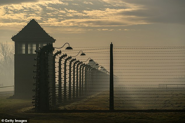 The fence that surrounds the Auschwitz II-Birkenau extermination camp is seen in a file photo. A new survey has found that two-thirds of American Millennials and members of Gen Z do not know that six million Jews were killed during the Holocaust
