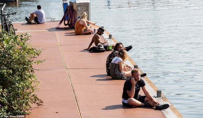 Britons are revelling in a 'second summer' hot spell of weather - with temperatures in the south expected to hit 81F (27C) before cooling off at the weekend. Pictured: People enjoy the last of the September sunshine in Bristol today