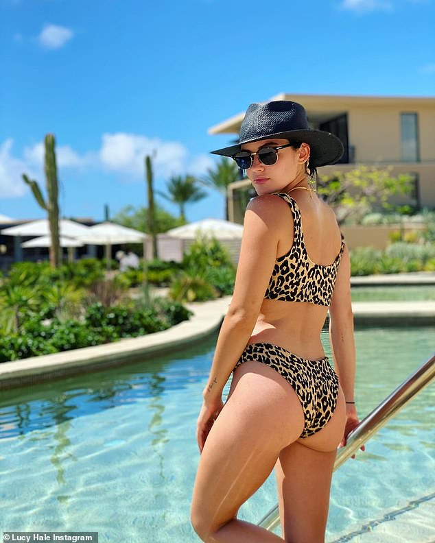 Blessings: Lucy Hale soaked up the last of the summer sun while on vacation with a friend in Cabo San Lucas, Mexico on Wednesday morning
