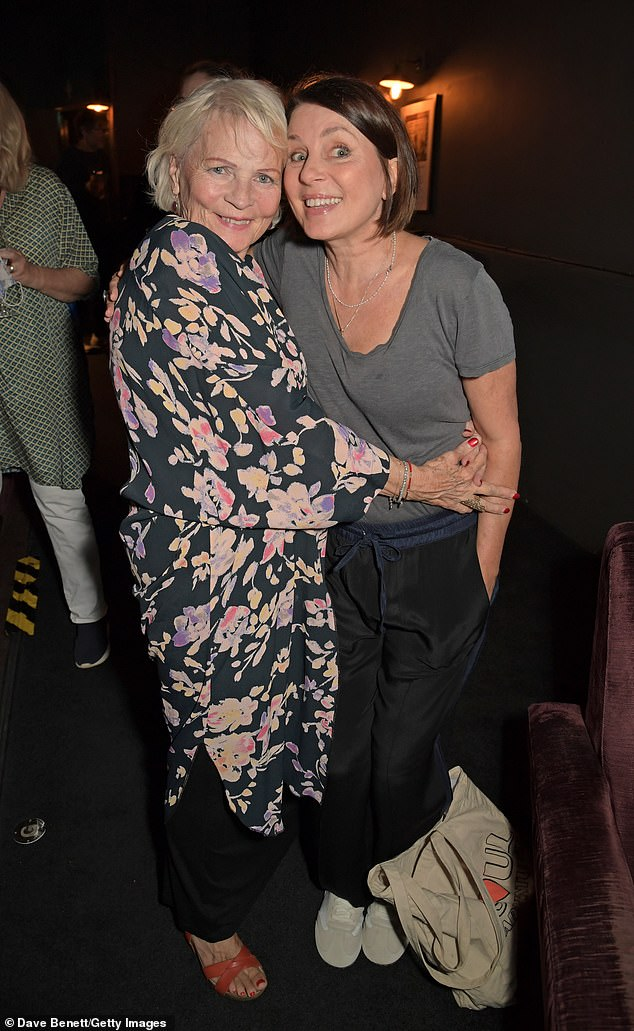 Hugs: Elsewhere at the screening, Sadie was supported by her mother Mary Davidson, as the duo smiled for the cameras, arms around each other