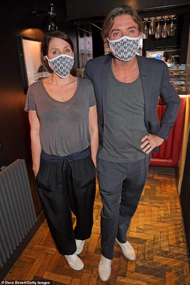 Covered!  Sadie and her businessman were seen wearing face masks at one point as they tried to stay protected inside the cinema