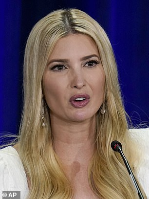 Accessory: Ivanka's dangly earrings peeked out from underneath her blonde hair as she spoke