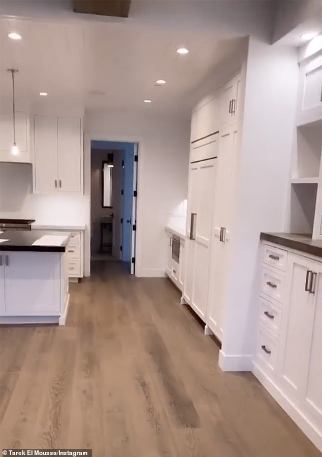 Room to work: 'This is basically the blank slate,' Heather says of the bare home and its all-white kitchen, which led to the living and dining rooms