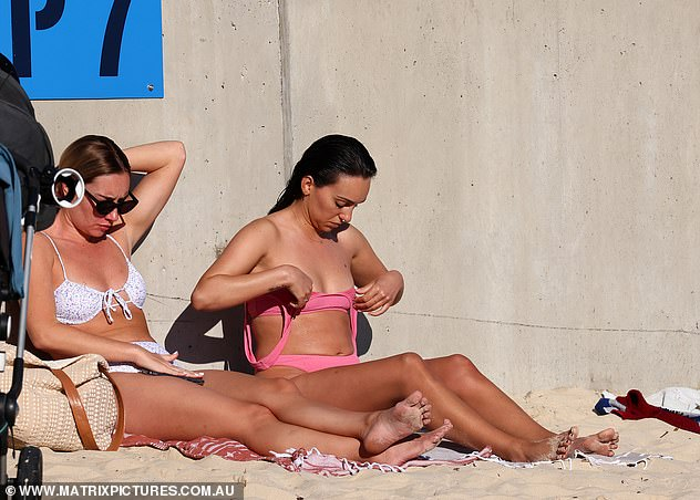 More pictures that spoil the end of The Bachelor: Bella Varelis wass spotted on Bondi Beach with fellow bachelorette Bec Cvilikas last weekend