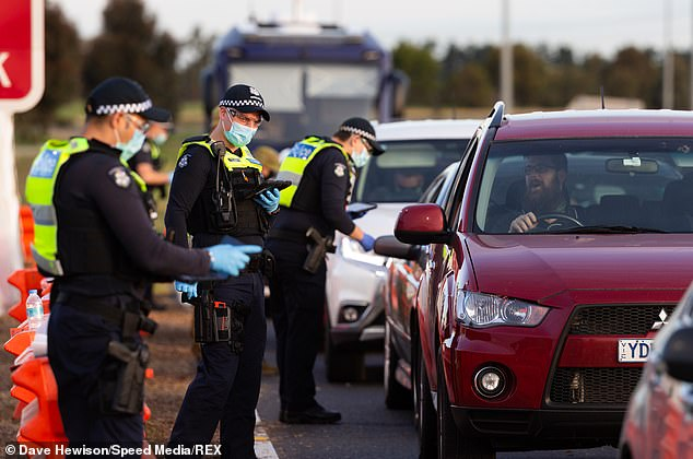 Police will use checkpoints at major highways, automatic number plate recognition and extra patrols at bus and train stations to catch city dwellers trying to escape strict coronavirus lockdown. Pictured: A checkpoint at Kalkallo