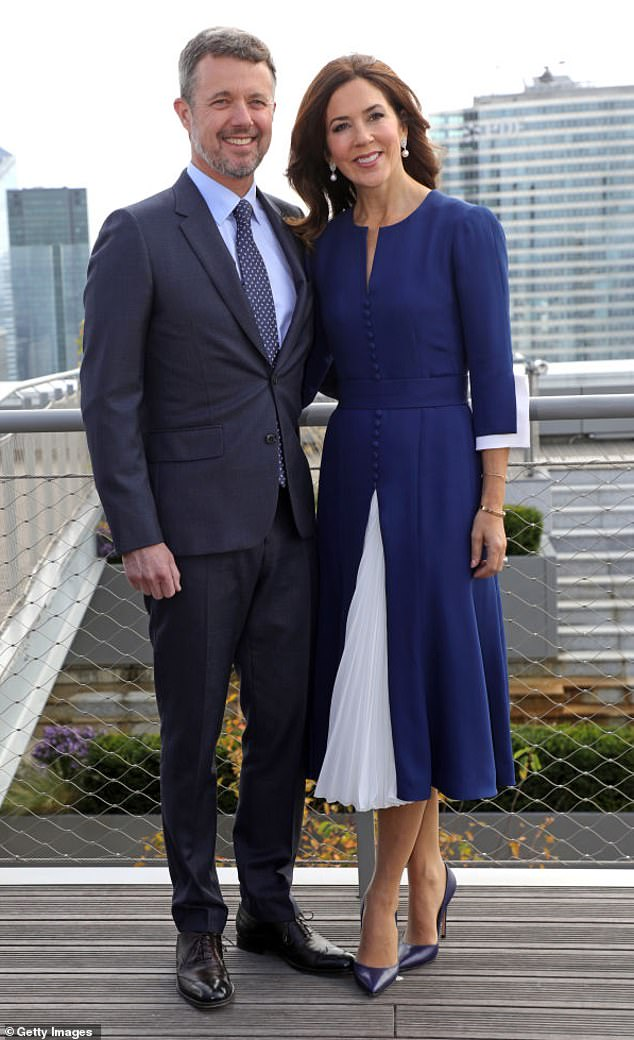 Now: Denmark's future king and queen beam at La Grande Arche in Paris on October 7, 2019, almost 20 years after their first encounter at a city centre pub during the Sydney Olympics