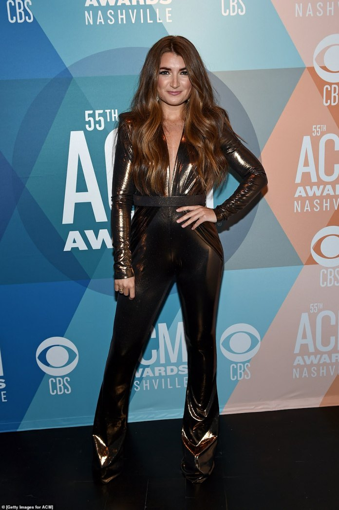 Winner: Canadian country singer Tenille Townes, 26, went with a shiny black jumpsuit belted at the waist. She won the award for new female artist