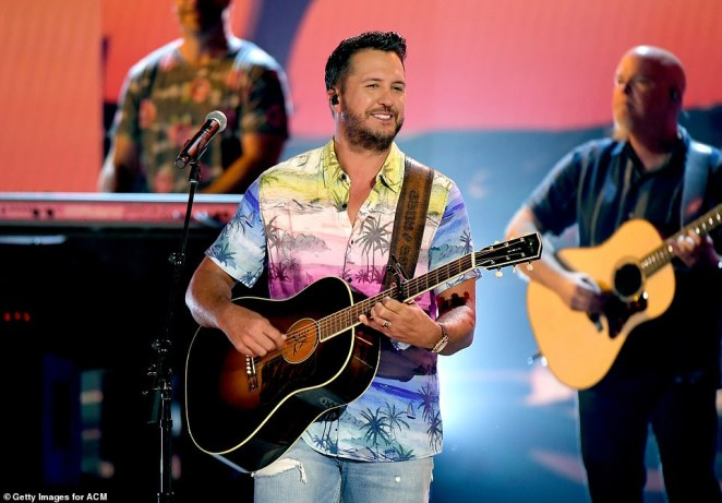 Party:Luke Bryan could hardly keep a smile off his face as he brought the party back to the socially-distanced award show with a performance of his fun-filled hit One Margarita